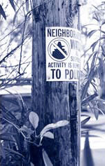 Neighborhood watch sign on a wooden pole.