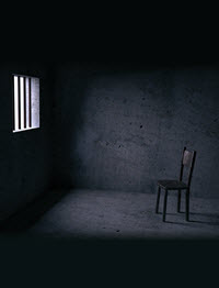 Chair in a dark prison cell