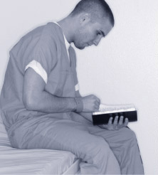 Man reading in a cell