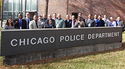 LEADS scholars posing behind Chicago Police Department sign