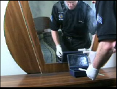 Still image linking toVideo Demonstrating Swabbing a Jewelry Box