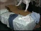 Still image linking toVideo Demonstrating Wrapping a Clothing Item Containing Biological Evidence