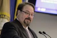 NIJ Director David B. Muhlhausen at the podium