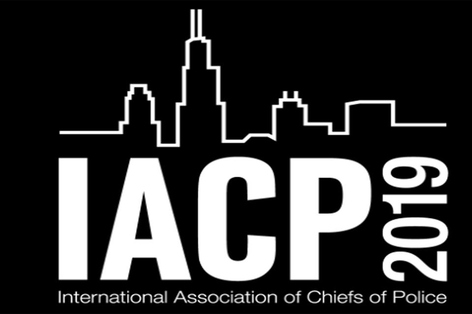"Black graphic with a white outline of Chicago skyline and the text ""IACP 2019 International Association of Chiefs of Police"""