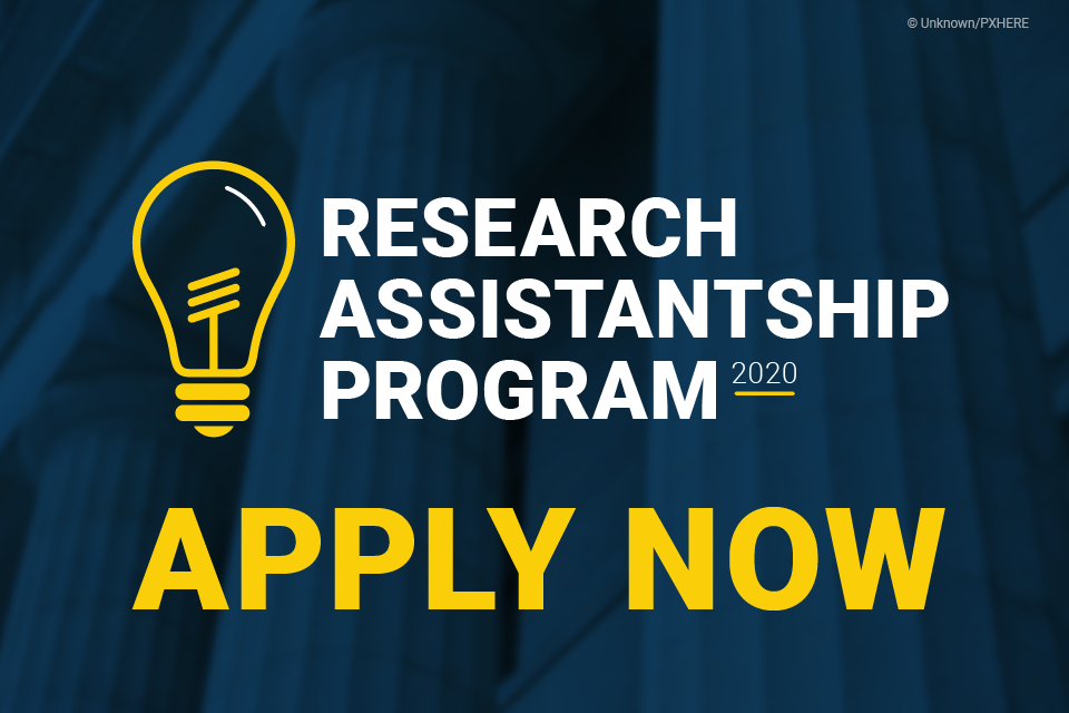 "Large building pillars with a blue color overlay, an image of a lightbulb, and the text ""Research Assistantship Program 2020 Apply Now"""