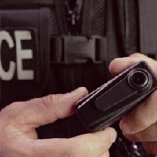 Officer holding body-worn camera