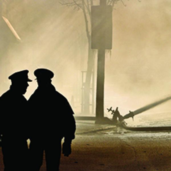 Two officers overlooking a disaster scene