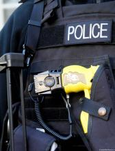 Police officer's vest with holstered Taser